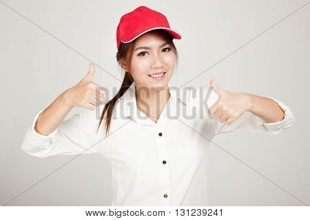 Happy Asian Girl  Thumbs Up With Red Hat