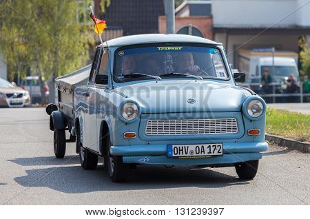 ALTENTREPTOW / GERMANY - MAY 1 2016: german trabant car drives on a street at oldtimer show on may 1 2016 in altentreptow germany.