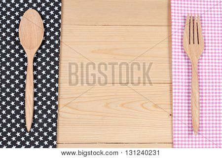 Color tablecloth spoon fork on table background
