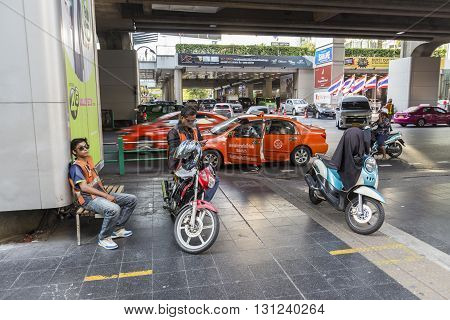 BANGKOK THAILAND - APR 24 : motorcycle taxi service in siam square on april 24 2016 thailand. siam square is famous shopping place of Bangkok