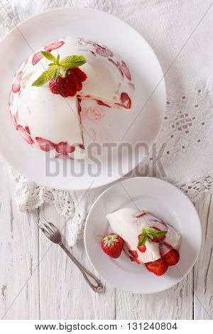 Cheesecake With Strawberries On A Plate Close Up. Vertical Top View