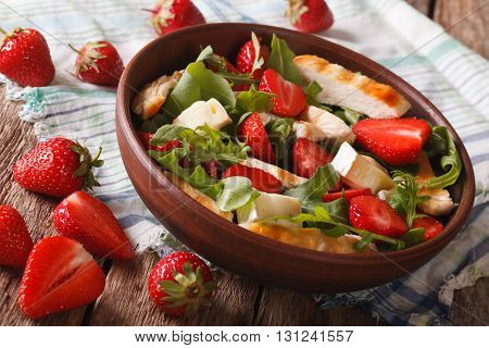 Fresh Salad With Strawberry, Chicken, Brie And Arugula Close-up. Horizontal