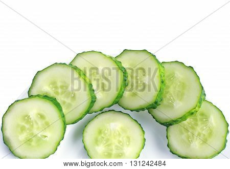 Sliced cucumber on plate Isolated on white background