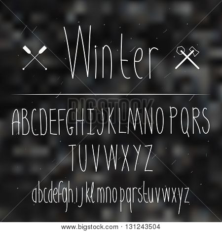 Cute hand drawn letter in the blurred background. Doodle type. Slim. Sans serif. Display faces. Uppercase and lowercase letters. Winter.