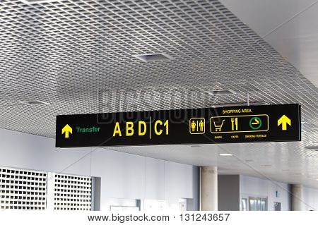 shopping area and transfer sign at international airport