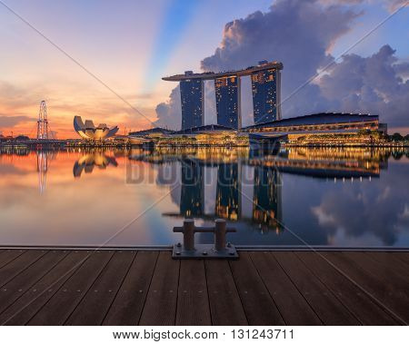 View on Marina Bay with docks on foreground. Modern city architecture at sunrise