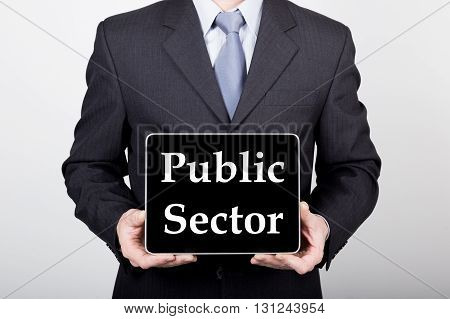 technology, internet and networking in business concept - businessman holding a tablet pc with public sector sign. Internet technologies in business.