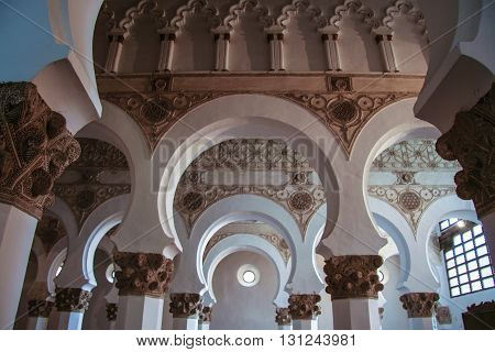 Toledo Spain - September 30 2007: Mudejar archs from Synagogue Santa Maria la Blanca. Construction date sometime in the late twelfth century or early thirteenth century