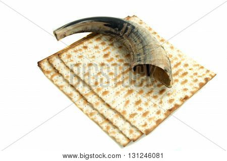 shofar and matze bread is isolated white background