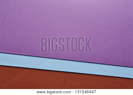 Colored cardboards background in brown blue purple tone. Copy space. Horizontal