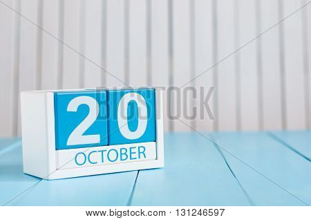 October 20th. Image of October 20 wooden color calendar on white background. Autumn day. Empty space for text.