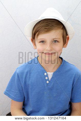 portrait of a cute blond boy with blue eyes