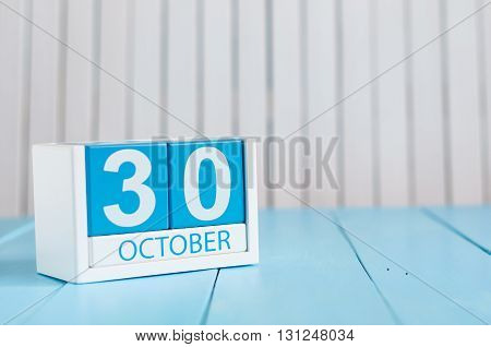 October 30th. Image of October 30 wooden color calendar on white background. Autumn day. Empty space for text.