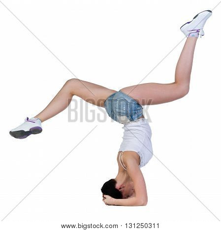 young woman dancing, headstand isolated in full body on white background