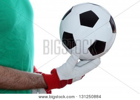 goal keeper with gloves takes a ball