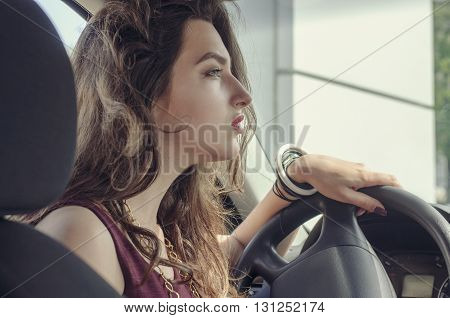 Woman Is Driving A Car