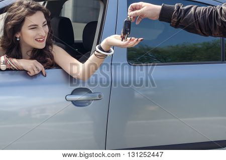 Man Gives A Girl The Keys To The Car