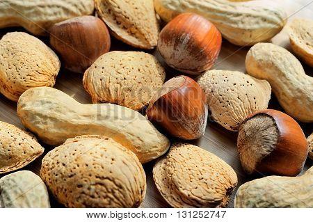 Almonds hazelnuts and peanuts healthy close macro