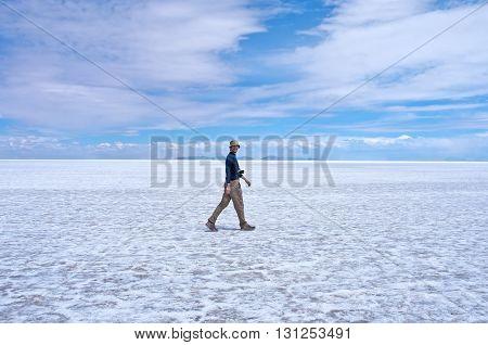 Man walks at Salar de Uyuni in Bolivia