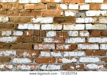 Texture Of Brick Wall With Cracked Bricks