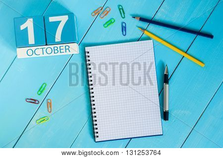 October 17th. Image of October 17 wooden color calendar on blue background. Autumn day. Empty space for text.