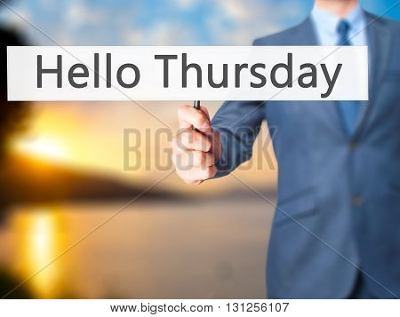 Hello Thursday - Businessman Hand Holding Sign