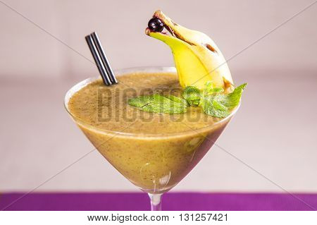 fresh smoothie from kiwi and banana with mint in restaurant