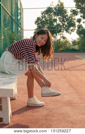 Portrait Of Beautiful Sport Girl Sitting In Tennis Courts Looking To Camera With Smiling Face Use Fo