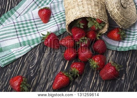 strawberries in a basket on the wooden desk