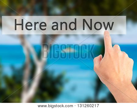 Here And Now - Hand Pressing A Button On Blurred Background Concept On Visual Screen.