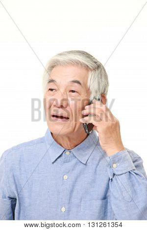 portrait of senior man with a smart phone on white background