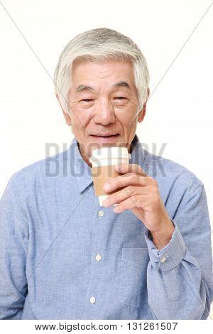 portrait of senior Japanese man takes a coffee break on white background