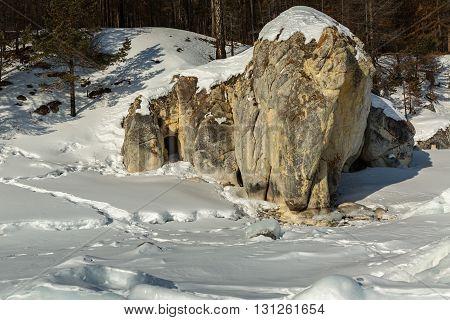 White Elephant Rock near Ushkany Islands. Beautiful winter landscape in the Lake Baikal.