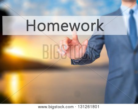 Homework - Businessman Hand Pressing Button On Touch Screen Interface.