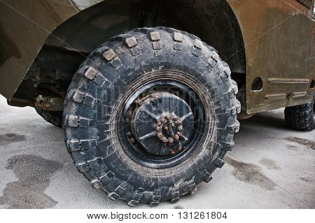 Close Up Wheel On Armored Military Car.
