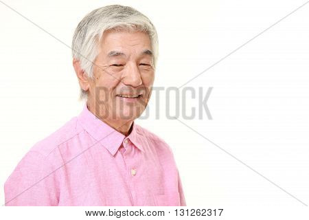 portrait of senior Japanese man in good mood on white background