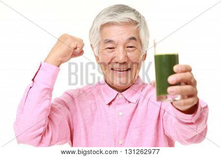 portrait of senior Japanese man with green vegetable juice on white background