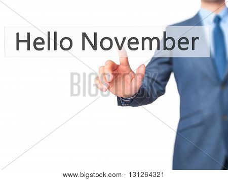 Hello November - Businessman Hand Pressing Button On Touch Screen Interface.