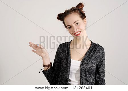 Young funny and cute hipster woman smiling and joking and making spectacles from her hands.