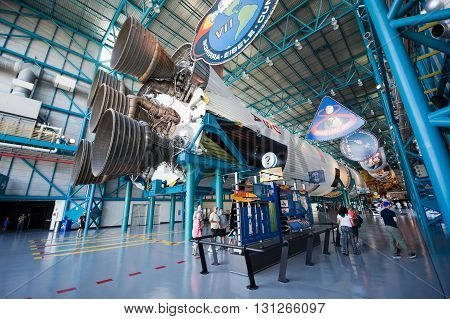 KENNEDY SPACE CENTER FLORIDA USA - APRIL 27 2016: Visitors looking at the Saturn 5 rocket which is exhibited at the visitor complex of Kennedy Space Center