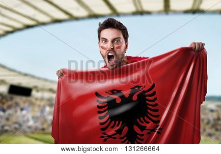 Fan holding the flag of Albania