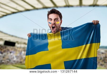 Fan holding the flag of Sweden