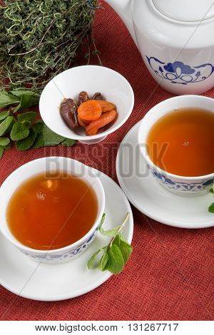 Asian tea set with herbs and fruits