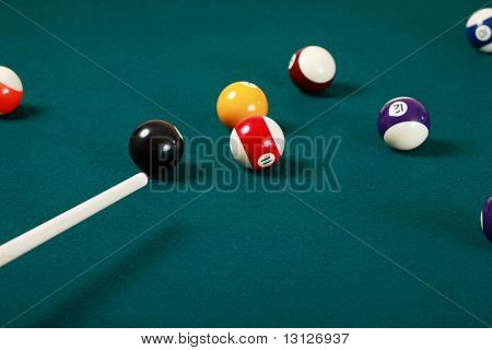 Billiard game details: balls, cue, table.