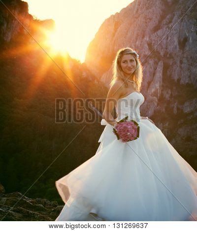 Beautiful bride in beautiful scenery at sunset