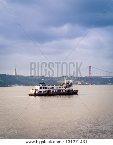 Ferry crossing the Tagus river in Lisbon Portugal