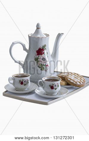 a tray with two cups of tea and tea biscuits