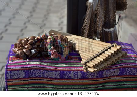 Traditional musical instruments of North American Indians lying on a mat