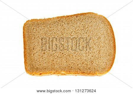 A loaf of bread on isolated background closeup. Hunk of bread baked with yeast with a porous inside.  Simple food of bread flour. Grey rustic bread.