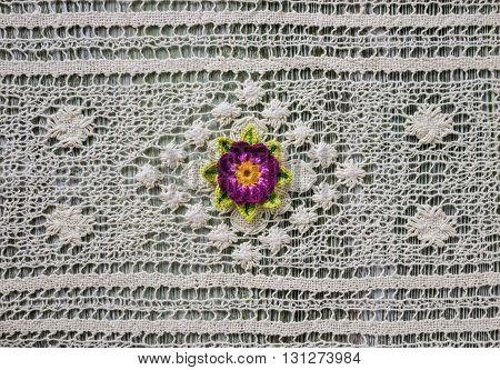 Crochet lotus flower on white vintage crochet lace